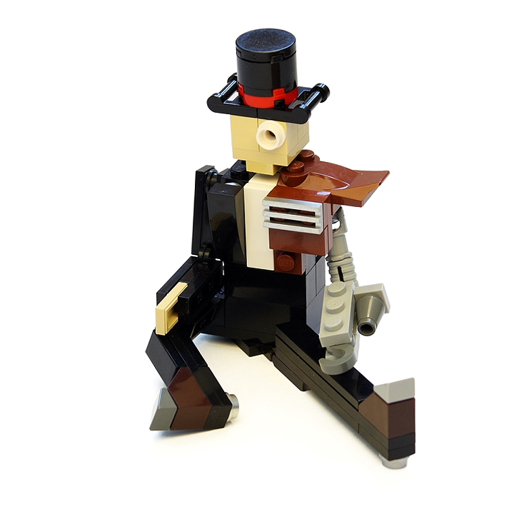 LEGO MOC - Steampunk Machine - Thomas Watts' Steam Motorcycle (Miniland): <br>Sir Thomas James Watt with his customary top hat and a monocle.<br>